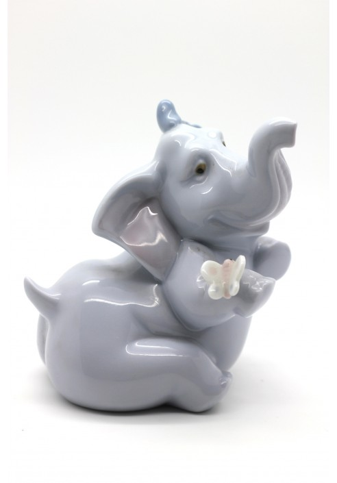 Nao porcelain figurine dont tell anybody elephant with flower - Consider including lladro porcelain figurines home decoration ...